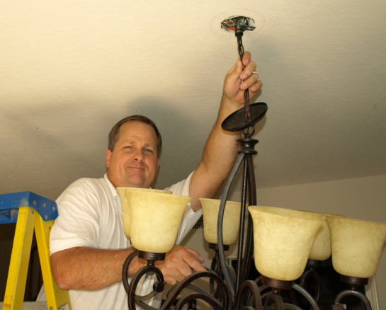 Lighting Calabasas Electrical Contractor Installing Chandelier